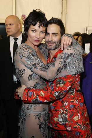 Backstage Kate cuddles friend and former Louis Vuitton creative director Marc Jacobs.