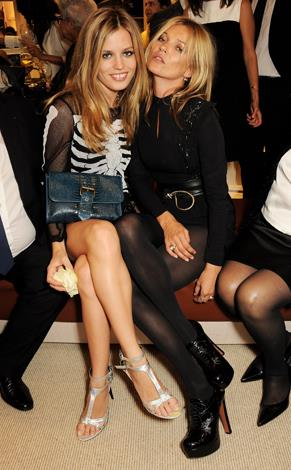 Kate sits front row with Georgia May Jagger at the launch of the Longchamp London flagship store in London in September, 2013.