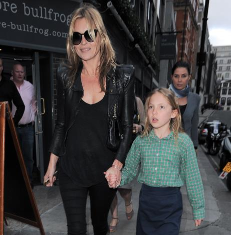 While she's not your average mum, Kate picks up daughter Lila from school under the prying eyes of the paparazzi.