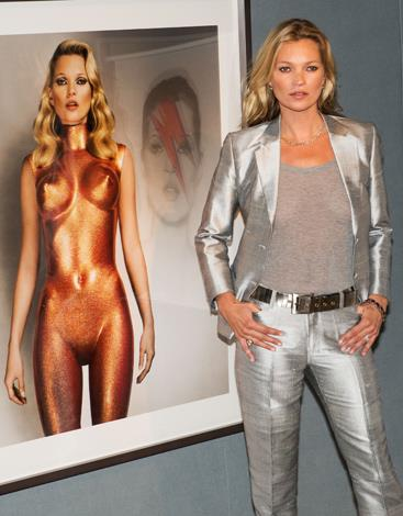 Kate Moss poses ahead of the 'Kate Moss The Collection' auction which saw various artworks of the model go under the hammer at London's Christie's in September, 2013.