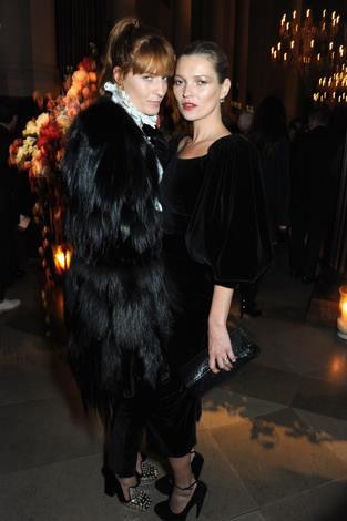 Kate Moss and musician Florence Welch attend the 2013 Alexander McQueen and Frieze Dinner.