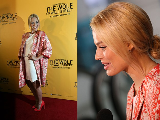 Margot Robbie was a little low key in a white mini dress and colourful pumps as she worked the cameras on the red carpet at the Brisbane premiere of The Wolf of Wall Street.