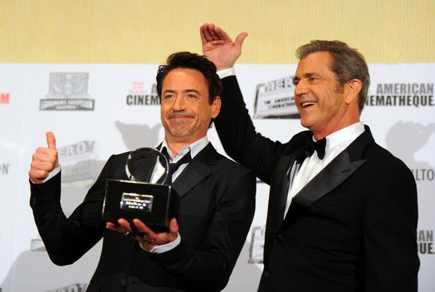 It's not easy to find anyone who will admit they're Mel Gibson's friend these days after the actor seemed to go on an alcohol fuelled bender and slam every minority group in America. But the Hollywood veteran can find a friend in Robert Downey Jr who used his speech at the 25th American Cinematheque Awards to ask everybody to ease up on his bro.