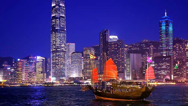 Hong Kong's night skyline and the traditonal junk Aqua Luna. Pic courtesy of Aqua Luna.