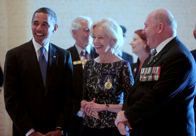 Dressed somberly at the Australian War Memorial with Barack Obama and incoming Governor-General Peter Cosgrove