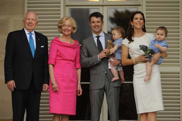 Pink is a favourite colour of Ms Bryce, seen here with Princess Mary and Frederick