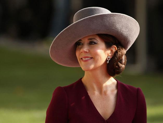 Princess Mary makes a style statement with this over sized hat while on a stroll in October 2012.
