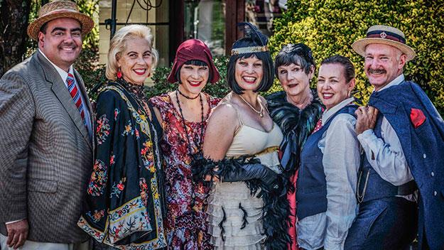 Revellers embracing the Roaring 20s theme.