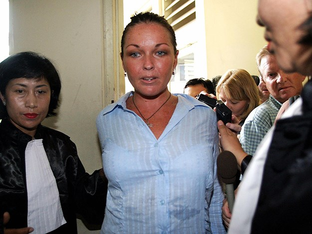 Escorted by prosecutors into a court room before her trial on 27 January 2005. Photo: AFP/Getty Images
