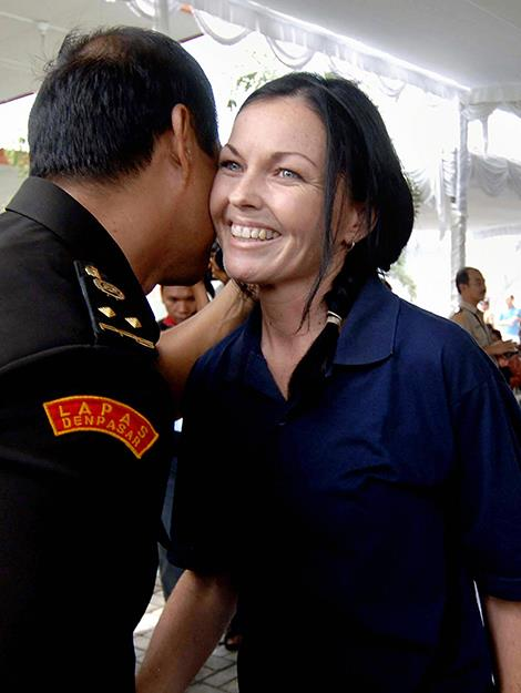 Schapelle is greeted by a prison official during a ceremony. Photo: AFP/Getty Images