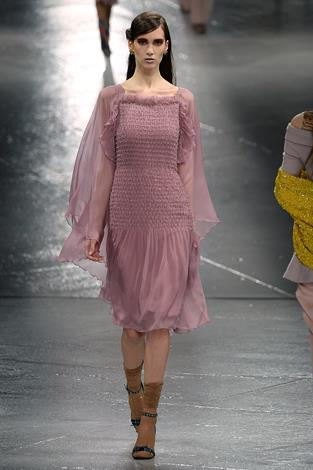 A model wears one of the most classically feminine garments in the collection.