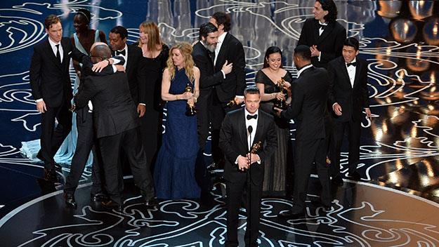 Producer Brad Pitt accepts the Best Picture award for '12 Years a Slave'.