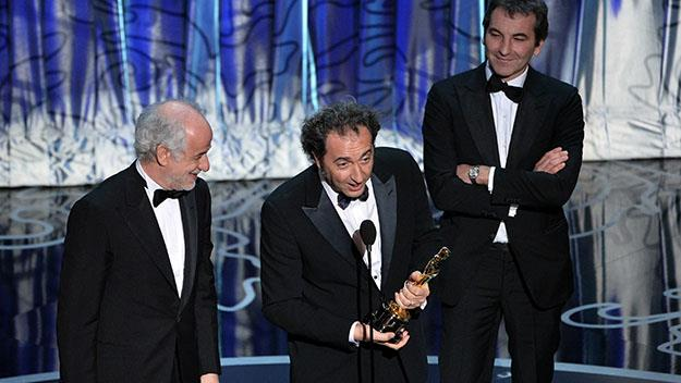 Actor Toni Servillo, director Paolo Sorrentino and producer Nicola Giuliano accept the award for 'The Great Beauty'.