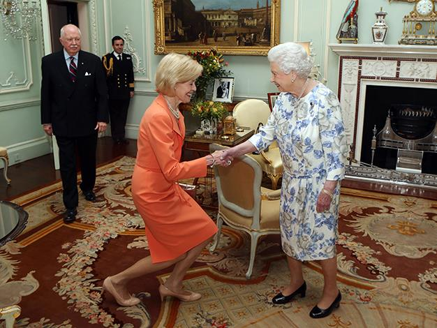 Queen Elizabeth II shakes hands as she meets the Honourable Quentin Bryce, Governor-General of Australia, and her husband Michael Bryce at Buckingham Palace on June 11, 2013 in London, England.