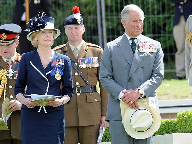 Prince Charles and Quentin Bryce pay their respect on July 19, 2010 in Fromelles, northern France, during the burial ceremony of an unknown World War One soldier, the last of the 250 found in a mass grave from the 1916 Battle of Fromelles.