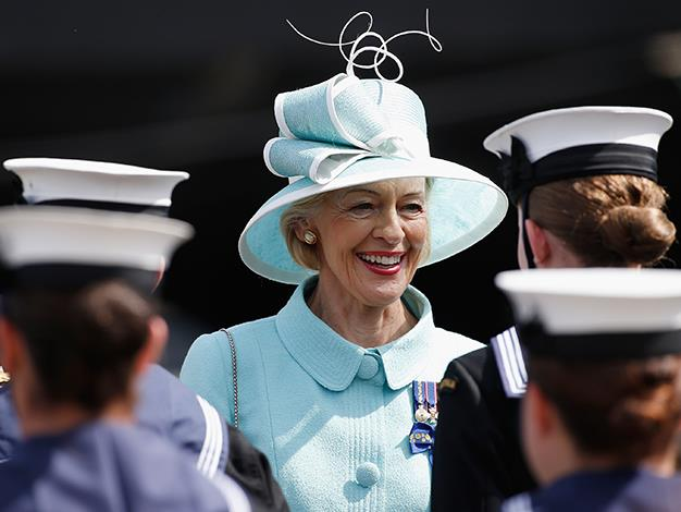 Quentin Bryce smiles as she inspects naval officers before boarding the Leeuwin on October 5, 2013 in Sydney, Australia.