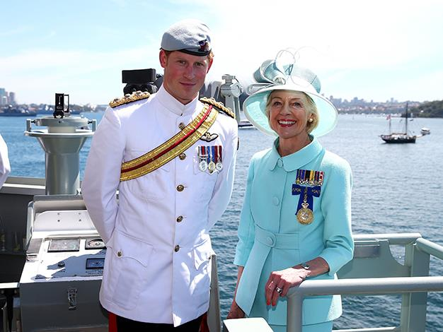 Prince Harry and Governor-General Quentin Bryce pose on board the HMAS Leeuwin as they participate in the 2013 International Fleet Review on October 5, 2013 in Sydney.