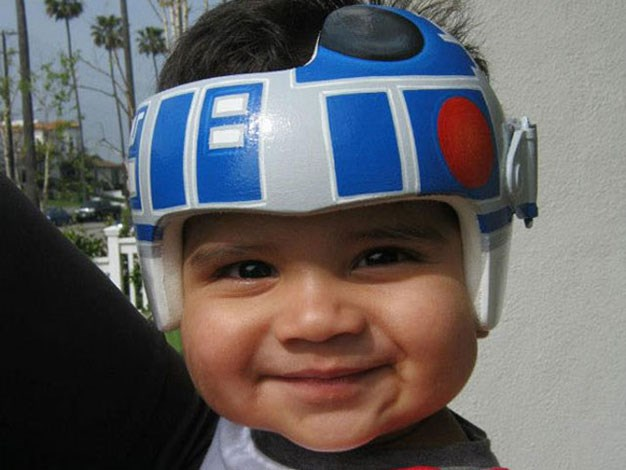 This little man looks very happy with his new helmet.