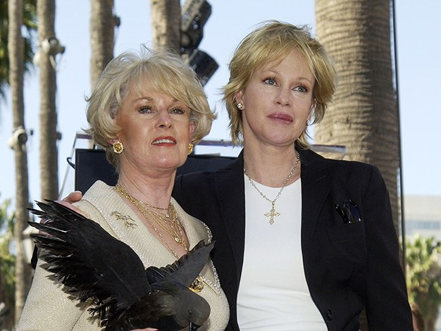 "Melanie Griffith's mother, former model Tippi Hedren, was one of Alfred Hitchcock's muses and starred in his 1963 classic, The Birds. As a child Griffiths admitted to being very creeped out by Hitchcock who presented her with a doll resembling her mother in a coffin one Christmas. ""He was a very weird guy,"" says Melanie."