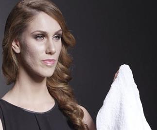 Cassandra Bankson wipes off her makeu