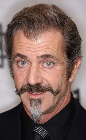 Mel Gibson's strange shaped beard suggests he's retired from movies and is now a full time ringmaster of a travelling circus.