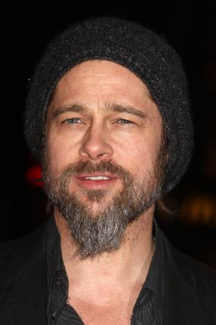 Brad Pitt literally looks like he shaved an animal and made a goatee chin wig with this woolly facial faux pas.