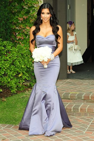 Kim Kardashian was a bridesmaid for her sister Khloe when she married basketball player Lamar Odem.