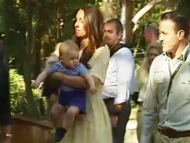 Prince George look very active in the Duchess' arms. Photo: British Royals @britishroyals via Twitter