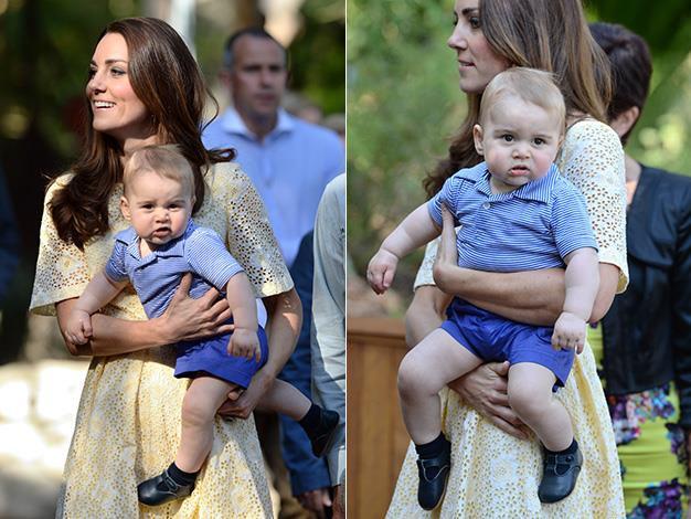 The little heir wriggles in his mother's arms as he is surrounded by attention. Photo: Splash Media