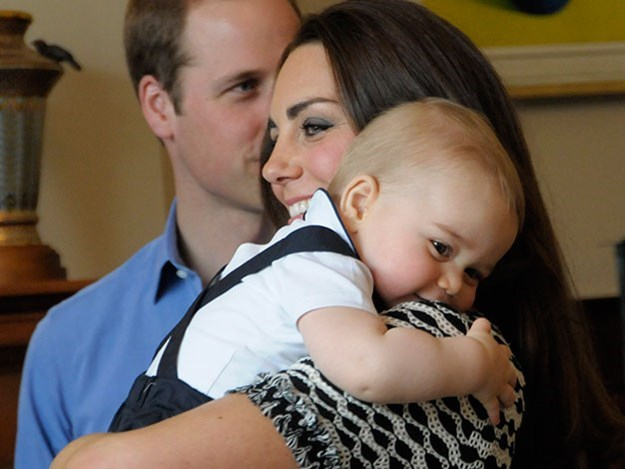 Cuddling up to his mum at one of his first public appearances.