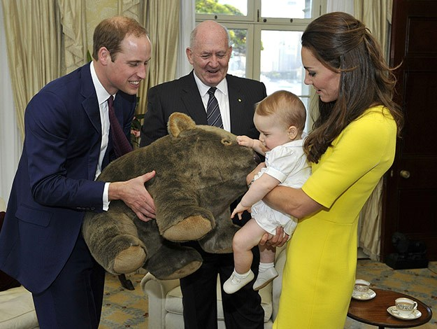 The baby heir receives a gift of a giant wombat from Governor-General Sir Peter Cosgrove.