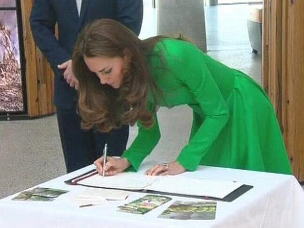 Duchess Catherine signs the arboretum visitors book. Photo: @channeltennews via Twitter
