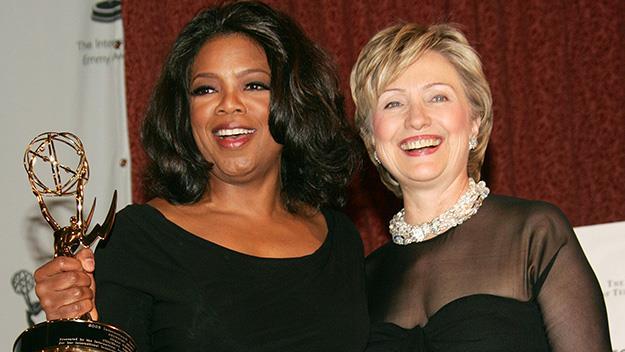 Oprah holding trophy