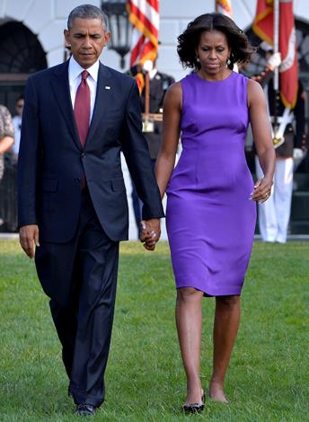 Michelle Obama with the President at the 9/11 anniversary in 2013.