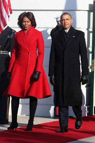 Michelle Obama as she waits to greet French President Francois Hollande during a welcoming ceremony on the South Lawn at the White House in February 2014.