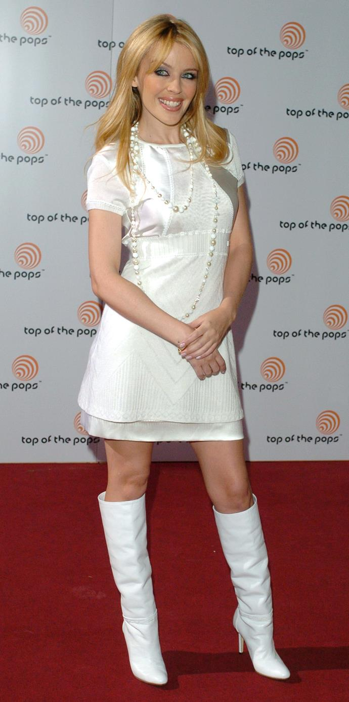 Kylie changed her locks in 2003 and paired a white dress with white boots.