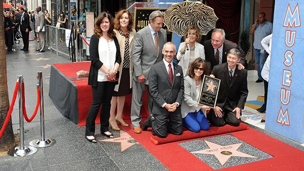 Sally Field poses at her star on the Hollywood Walk of Fame.