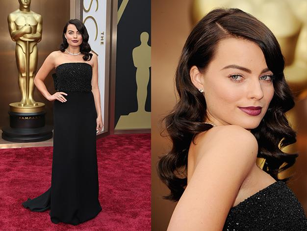 For her first Oscars, Margot chose a black Saint Laurent gown.