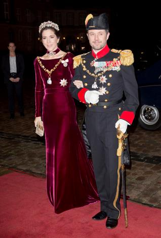 Mary channels the traditional in this floor length velvet gown and jewel encrusted tiara as she and Crown Prince Frederik arrive at the New Year's Banquet hosted by Queen Margrethe of Denmark in January 2014.