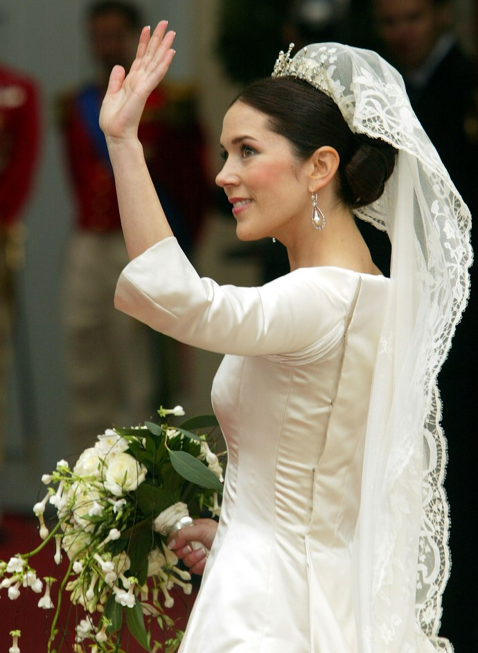 Mary gives the crowds a final wave before marrying her prince.