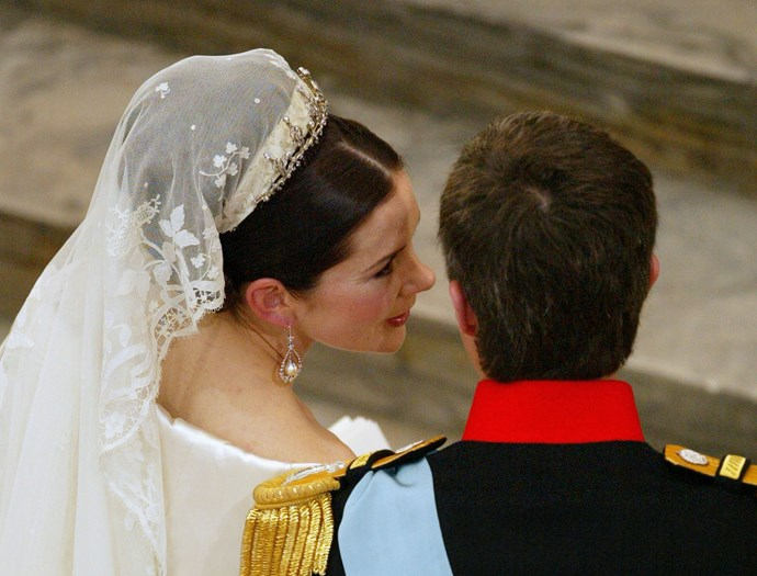 The pair share a private moment at the altar.
