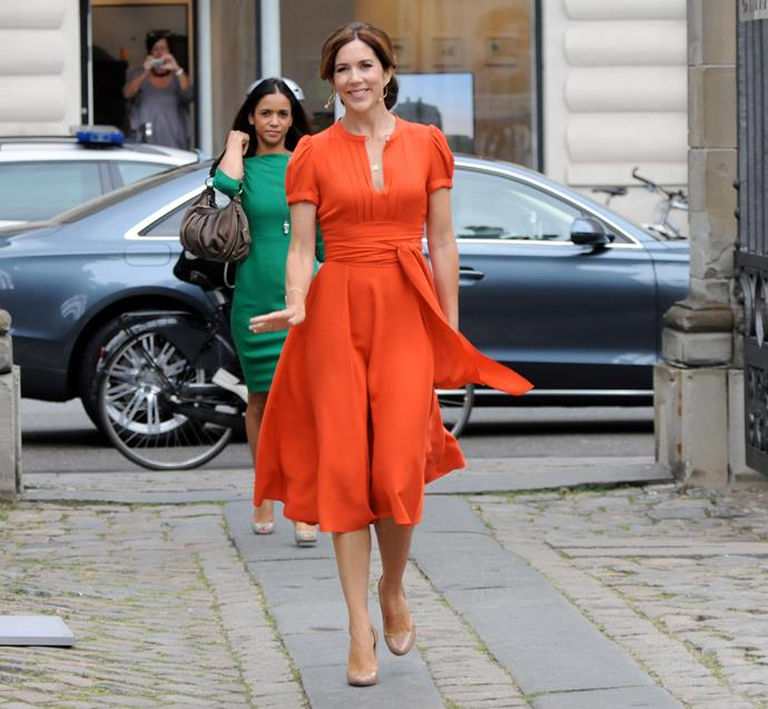Mary looked super stylish in this orange ensemble. The royal teamed the chic citrus look with nude pumps and minimal accessories as she attended an official palace engagement in Copenhagen in August, 2012.