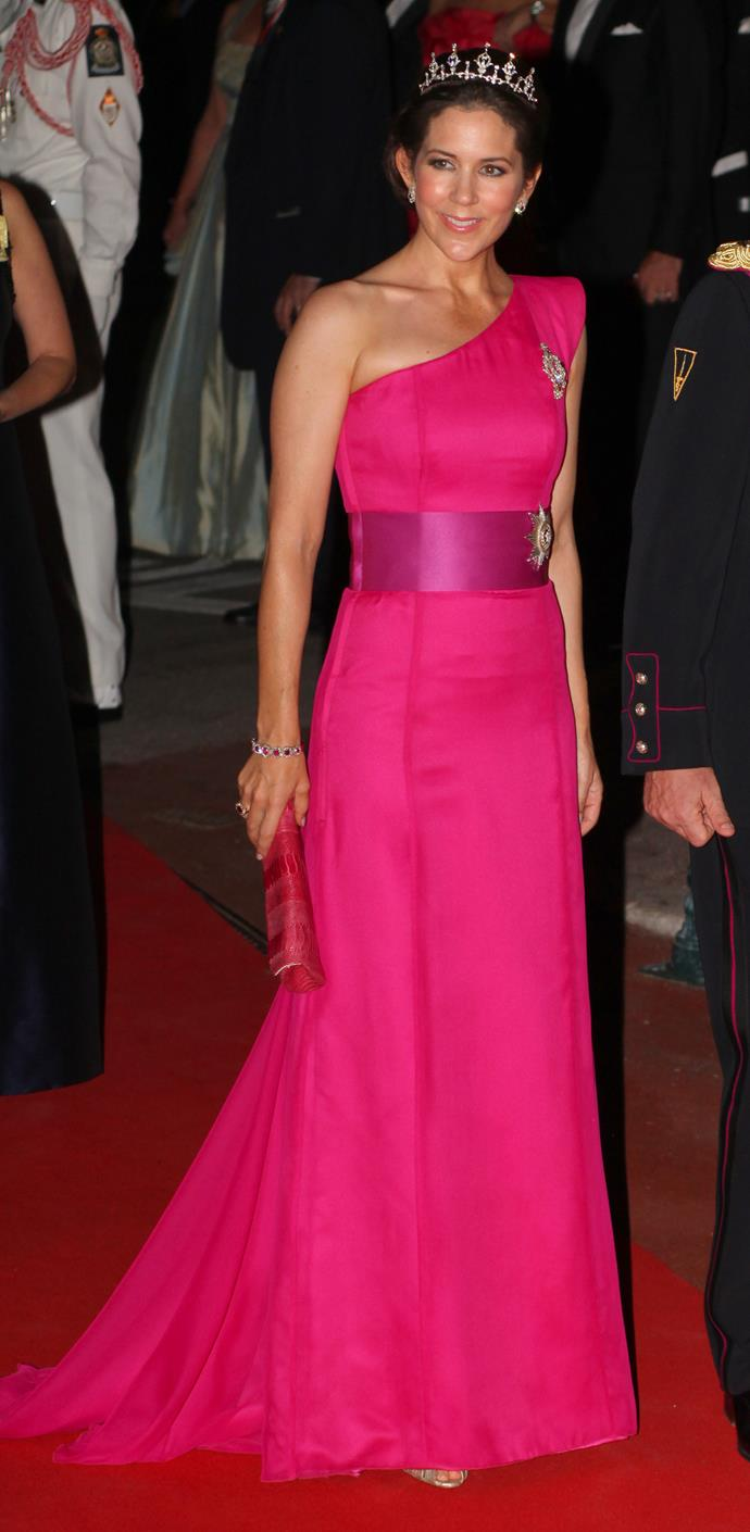 The Crown Princess isn't afraid of experimenting with colour as demonstrated in this magical hot pink number.