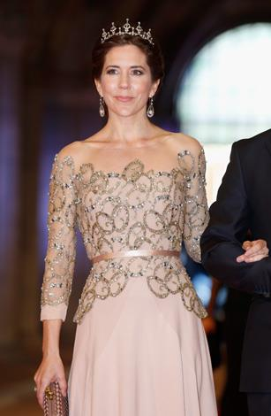 Mary is the picture of elegance in this bejeweled nude creation and crown as she attends a dinner hosted by Queen Beatrix of The Netherlands in 2013.