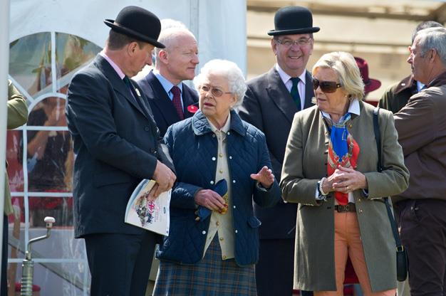 Her Majesty looked relaxed as she chatted with friends. Photo: Getty
