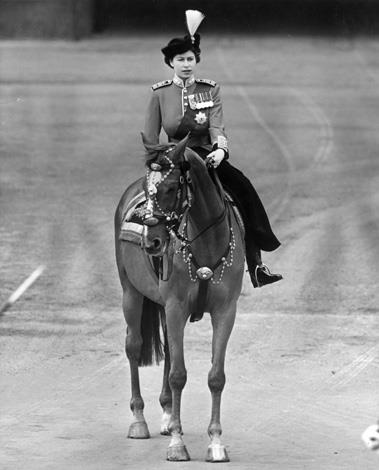 Princess Elizabeth II riding side saddle during a Trooping the Colour ceremony at Horse Guard's Parade, London in 1951. Photo: Getty