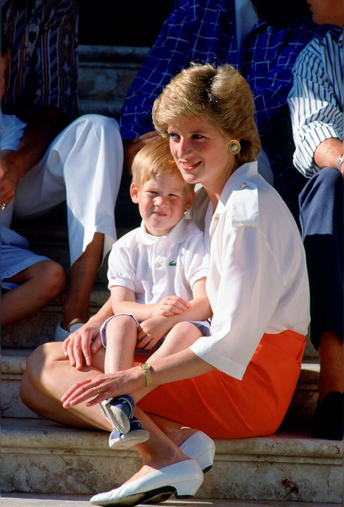 Diana, Princess Of Wales, Sitting On The Steps Of The Marivent Palace With Her Son, Prince Harry.