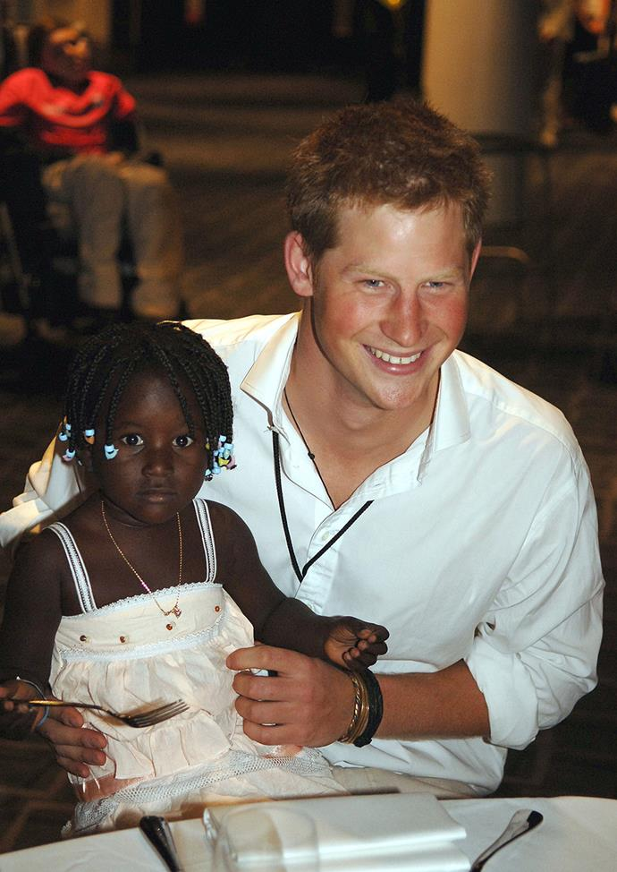 Prince Harry holds 3-year-old Eufrafina in 2007.