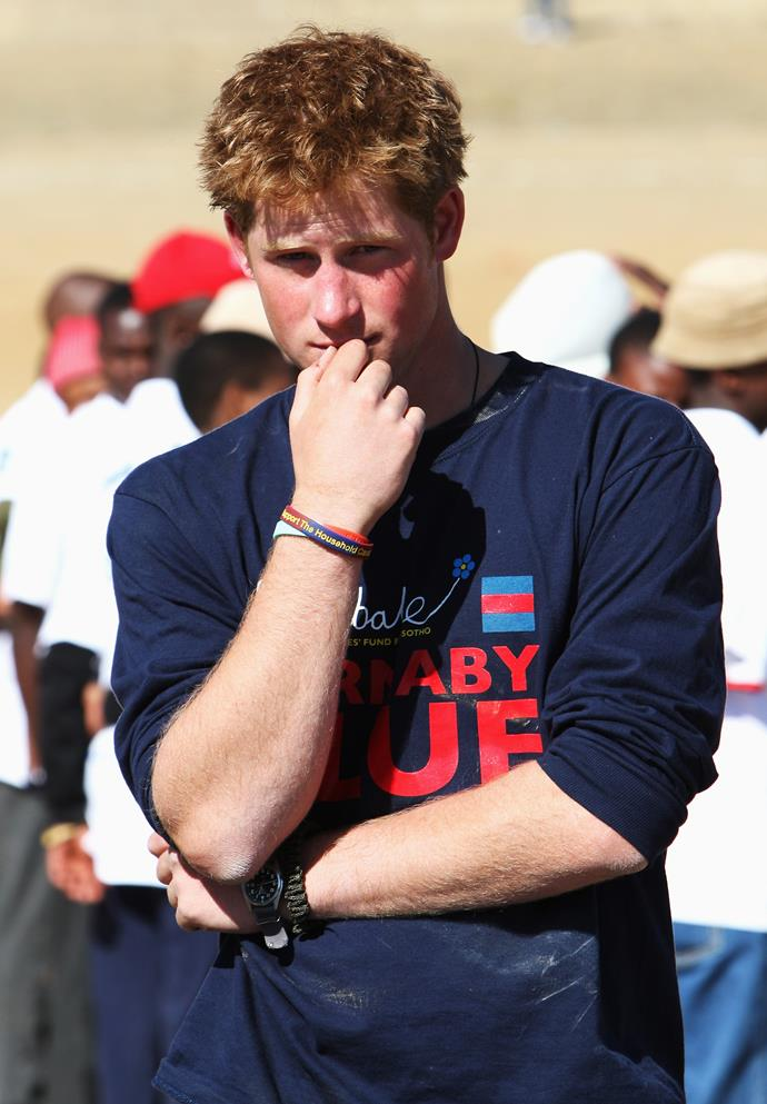 Prince Harry plays a game highlighting AIDS/HIV awareness on July 8, 2008 in Buthe Buthe, Lesotho.