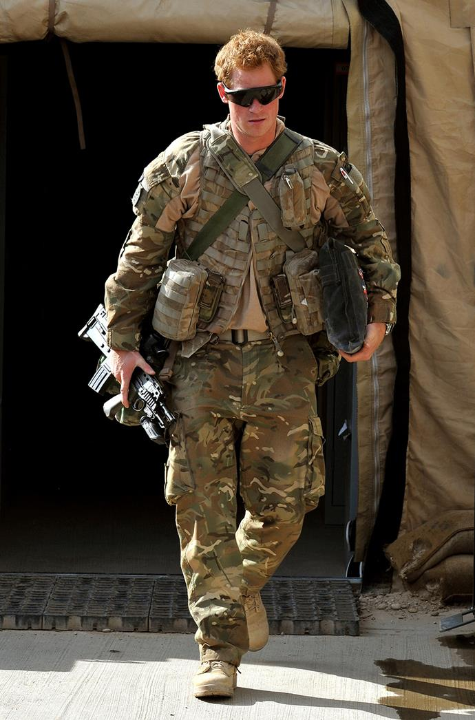 Prince Harry walking out of a tent at the British controlled flight-line at Camp Bastion in Afghanistan's Helmand Province.